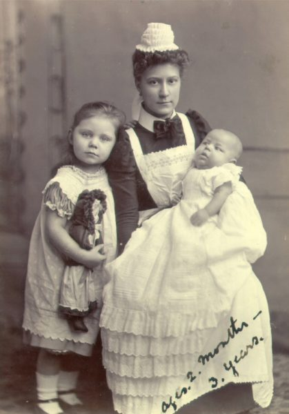 Two young children with their nanny