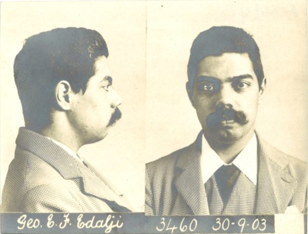 Side and front mugshot photographs of a man with a moustache