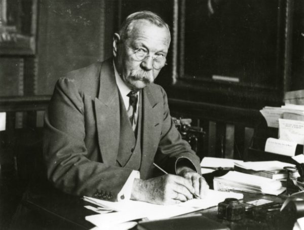 Arthur Conan Doyle at his writing desk in the 1920s