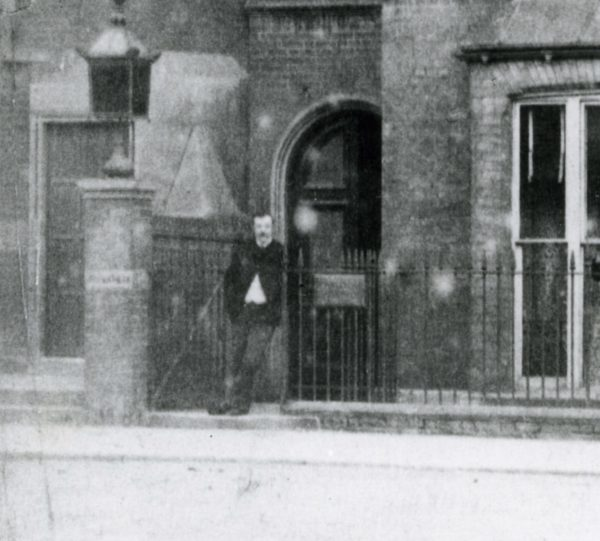 Conan Doyle standing outside his home and practice at Bush Villas in Southsea.