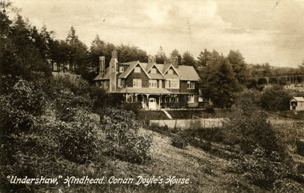 A postcard featuring a photograph of Undershaw house
